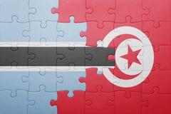 γρίφος με τη εθνική σημαία της Τυνησίας και της Μποτσουάνα Στοκ Φωτογραφίες