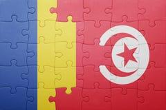 γρίφος με τη εθνική σημαία της Τυνησίας και της Ρουμανίας Στοκ Φωτογραφία