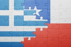 Γρίφος με τη εθνική σημαία της Χιλής και της Ελλάδας Στοκ φωτογραφία με δικαίωμα ελεύθερης χρήσης