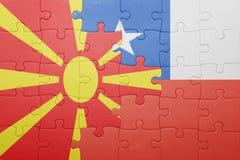Γρίφος με τη εθνική σημαία της Χιλής και της Μακεδονίας Στοκ Φωτογραφία
