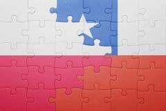 Γρίφος με τη εθνική σημαία της Χιλής και της Πολωνίας Στοκ εικόνα με δικαίωμα ελεύθερης χρήσης
