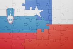 Γρίφος με τη εθνική σημαία της Χιλής και της Σλοβενίας Στοκ Φωτογραφίες