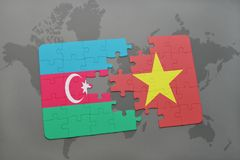 γρίφος με τη εθνική σημαία του Αζερμπαϊτζάν και του Βιετνάμ σε έναν παγκόσμιο χάρτη Στοκ φωτογραφία με δικαίωμα ελεύθερης χρήσης