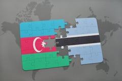 γρίφος με τη εθνική σημαία του Αζερμπαϊτζάν και της Μποτσουάνα σε έναν παγκόσμιο χάρτη Στοκ Εικόνες