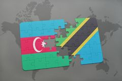 γρίφος με τη εθνική σημαία του Αζερμπαϊτζάν και της Τανζανίας σε έναν παγκόσμιο χάρτη Στοκ φωτογραφία με δικαίωμα ελεύθερης χρήσης