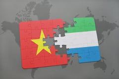γρίφος με τη εθνική σημαία του Βιετνάμ και της Σιέρα Λεόνε σε έναν παγκόσμιο χάρτη Στοκ Εικόνες