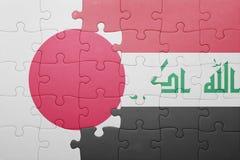 Γρίφος με τη εθνική σημαία του Ιράκ και της Ιαπωνίας Στοκ Φωτογραφία