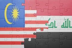 Γρίφος με τη εθνική σημαία του Ιράκ και της Μαλαισίας Στοκ Εικόνες