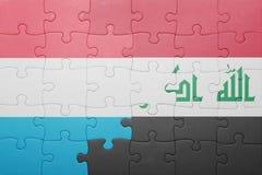 γρίφος με τη εθνική σημαία του Λουξεμβούργου και του Ιράκ Στοκ Εικόνες