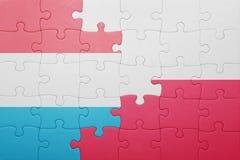 Γρίφος με τη εθνική σημαία του Λουξεμβούργου και της Πολωνίας Στοκ εικόνα με δικαίωμα ελεύθερης χρήσης