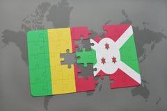 γρίφος με τη εθνική σημαία του Μαλί και του Μπουρούντι σε έναν παγκόσμιο χάρτη Στοκ φωτογραφία με δικαίωμα ελεύθερης χρήσης