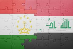 γρίφος με τη εθνική σημαία του Τατζικιστάν και του Ιράκ Στοκ Εικόνες
