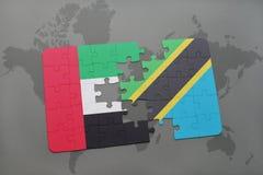 γρίφος με τη εθνική σημαία των Ηνωμένων Αραβικών Εμιράτων και της Τανζανίας σε έναν παγκόσμιο χάρτη Στοκ φωτογραφίες με δικαίωμα ελεύθερης χρήσης