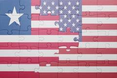 Γρίφος με τη εθνική σημαία των Ηνωμένων Πολιτειών της Αμερικής και της Λιβερίας Στοκ φωτογραφία με δικαίωμα ελεύθερης χρήσης