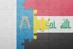 γρίφος με τη εθνική σημαία των Κανάριων νησιών και του Ιράκ Στοκ Εικόνες