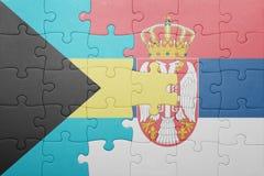 Γρίφος με τη εθνική σημαία των Μπαχαμών και της Σερβίας Έννοια Στοκ Εικόνα