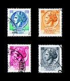 Γραμματόσημα που τυπώνονται στην Ιταλία των νομισμάτων από τις Συρακούσες serie, circa 1955 στοκ εικόνα