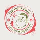 Γραμματόσημο Χριστουγέννων με Άγιο Βασίλη κόκκινος και πράσινος με τους λεκέδες και τα κεριά απεικόνιση αποθεμάτων