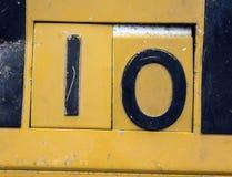 Γραπτή διατύπωση στο στενοχωρημένο κρατικό τυπογραφία αριθμό 10 οι Δέκα Στοκ φωτογραφία με δικαίωμα ελεύθερης χρήσης