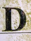 Γραπτή διατύπωση στο στενοχωρημένο κρατικό τυπογραφία γράμμα Δ Στοκ Εικόνα
