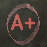 A+ γραπτός σε έναν πίνακα Στοκ Εικόνα