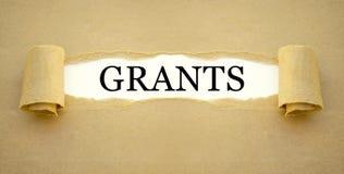 Γραφική εργασία με την κυβερνητική επιχορήγηση για να χρηματοδοτήσει την καθιέρωση μιας νέας επιχείρησης στοκ φωτογραφίες με δικαίωμα ελεύθερης χρήσης