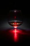 Γυαλί κονιάκ με το κόκκινο φως Στοκ εικόνα με δικαίωμα ελεύθερης χρήσης