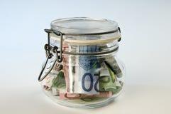 Γυαλί με τα χρήματα στοκ εικόνες