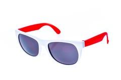 Γυαλιά ηλίου παιδιών χρώματος, σκιές ήλιων ή θεάματα που απομονώνονται επάνω Στοκ Εικόνα