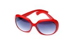 Γυαλιά ηλίου στο κόκκινο πλαίσιο Στοκ φωτογραφία με δικαίωμα ελεύθερης χρήσης