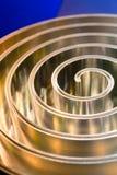 Γυαλισμένο σπείρα μέταλλο μετάλλων πεδίο βάθους ρηχό Στοκ Εικόνες