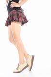 Γυμνά θηλυκά πόδια στις μπότες Στοκ Εικόνες