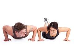 Γυναίκα άσκησης με τον εκπαιδευτή Στοκ φωτογραφία με δικαίωμα ελεύθερης χρήσης