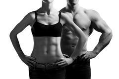 γυναίκα ανδρών γυμναστική& Στοκ Εικόνες