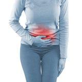 Γυναίκα γύρω από το waistline για να παρουσιάσει πόνο στην περιοχή κοιλιών Στοκ εικόνα με δικαίωμα ελεύθερης χρήσης