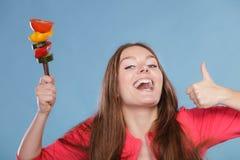Γυναίκα ικανότητας με τα λαχανικά Να κάνει δίαιτα αδυνάτισμα Στοκ Εικόνες