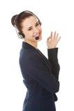 γυναίκα κασκών τηλεφωνι&kap Στοκ φωτογραφία με δικαίωμα ελεύθερης χρήσης