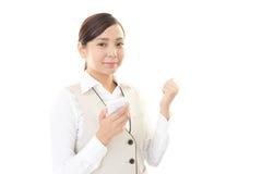 Γυναίκα με ένα έξυπνο phone  Στοκ Εικόνα