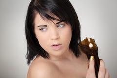 Γυναίκα με ένα μπουκάλι Στοκ φωτογραφία με δικαίωμα ελεύθερης χρήσης