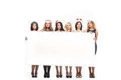 Γυναίκα με ένα σημάδι στο άσπρο καπέλο Χριστουγέννων Στοκ Εικόνες