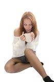 Γυναίκα με ένα φλυτζάνι. Στοκ Φωτογραφία