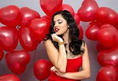Γυναίκα με κόκκινα ballons Στοκ Εικόνα