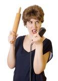 Γυναίκα με μια κυλώντας καρφίτσα στην τηλεφωνική κραυγή Στοκ Εικόνες