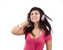 Γυναίκα με τα ακουστικά στοκ φωτογραφία με δικαίωμα ελεύθερης χρήσης
