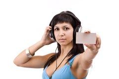 Γυναίκα με τα ακουστικά στοκ εικόνα με δικαίωμα ελεύθερης χρήσης