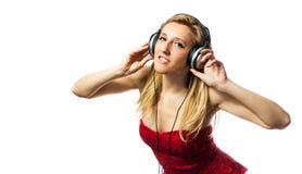 Γυναίκα με τα ακουστικά στοκ εικόνες με δικαίωμα ελεύθερης χρήσης