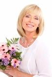 Γυναίκα με τα λουλούδια στοκ φωτογραφία με δικαίωμα ελεύθερης χρήσης