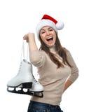 Γυναίκα με τα σαλάχια πάγου που παίρνουν έτοιμα για το χειμερινό αθλητισμό πατινάζ πάγου Στοκ Εικόνες