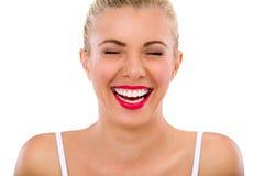 Γυναίκα με τα όμορφα γέλια δοντιών στοκ εικόνα