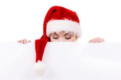 Γυναίκα με τον κενό κενό πίνακα εμβλημάτων Χριστούγεννα Στοκ Εικόνα